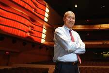GHS Band Director John Yoon poses in the Greenwich High School MISA Auditorium in Greenwich, Conn. Monday, Jan. 25, 2016.