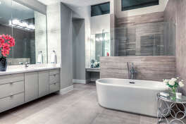 This bathroom with freestanding bathtub also includes quartz countertops.
