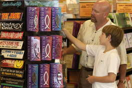 9/25/2003--The Family Christian Store in Sugarland, part of a chain, opened foor business for the first time, Sunday, following the lead of a store in Dallas.  Steve Cooksey with his son, William, shopped together.    Photo  by Steve Ueckert / Chronicle.  HOUCHRON CAPTION  (10/04/2003):   Steve Cooksey and son William shop at the Family Christian Store Sunday in Sugar Land, one of the chain's 315 stores opening for business on the Sabbath.