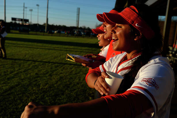 Lamar softball players cheer from the dugout during their home opener against Alabama A&M on Thursday afternoon. The Cardinals won 6-3.  Photo taken Thursday 2/23/17 Ryan Pelham/The Enterprise