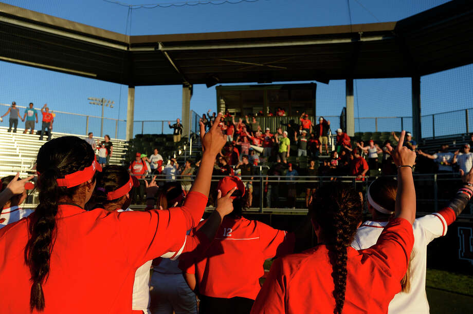 Lamar softball players and coaches put their Ls in the air during the alma mater after winning their home opener against Alabama A&M on Thursday afternoon. The Cardinals won 6-3.  Photo taken Thursday 2/23/17 Ryan Pelham/The Enterprise Photo: Ryan Pelham / ©2017 The Beaumont Enterprise/Ryan Pelham