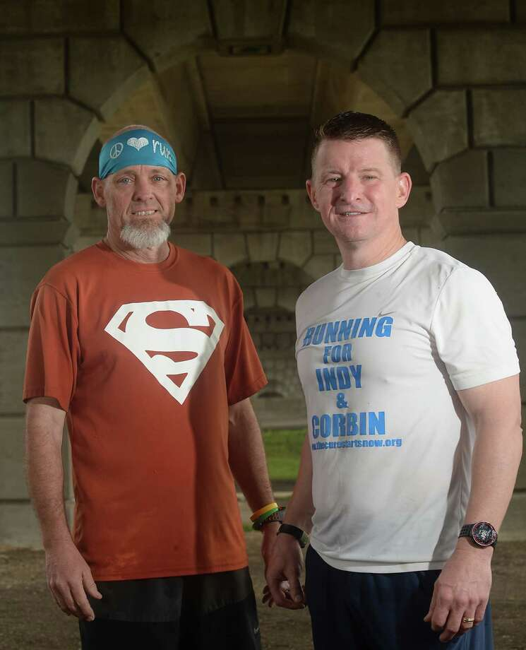 """Runners Ike Adams (left) and Dave Jones are both in training for this year's Gusher Marathon. The pair will team up again later this spring when they head north to take part in the Boston Marathon. Adams and Jones are pairing their love of running with a cause near and dear to their hearts, """"Running for a Purpose"""" to raise funds for The Cure Starts Now Foundation. Photo taken Saturday, February 18, 2017 Kim Brent/The Enterprise Photo: Kim Brent"""