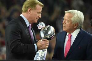 NFL commissioner Roger Goodell hands the Lombardi Trophy to New England Patriots owner Robert Kraft after defeating the Atlanta Falcons during Super Bowl 51 at NRG Stadium on February 5, 2017 in Houston, Texas. The Patriots defeated the Falcons 34-28 after overtime.  / AFP PHOTO / Timothy A. CLARYTIMOTHY A. CLARY/AFP/Getty Images