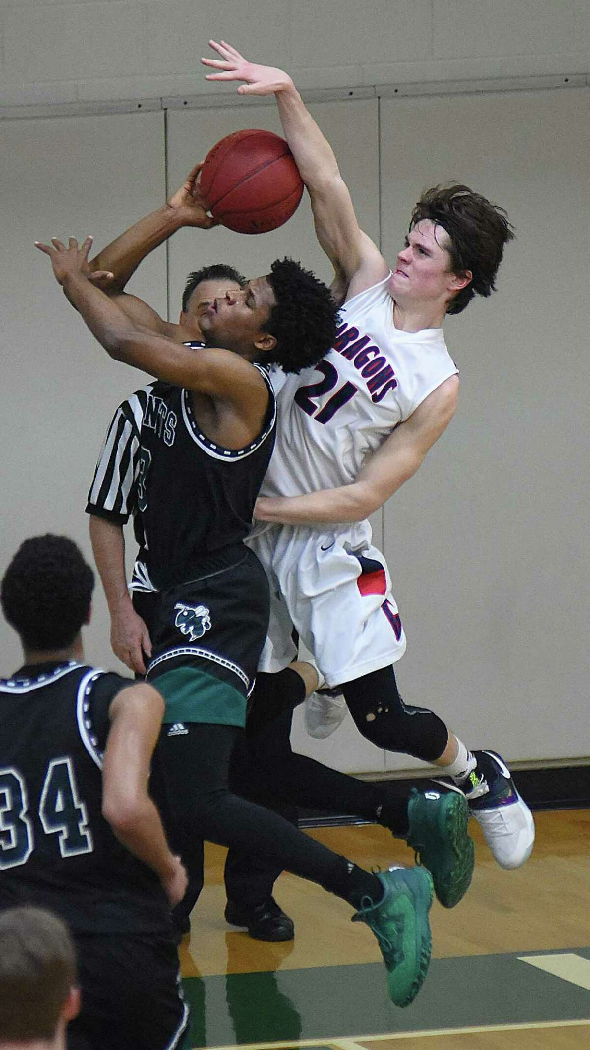 Greens Farms Academy's Bennett Close, right, fouls Hamden Hall's TJ Rountree during the second half of Thursday's FAA boys basketball semifinal.