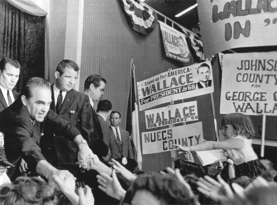 Presidential candidate George Wallace reaches out  for the hands  of his supporters at the Texas State convention of his  American Party  in Dallas in 1968.