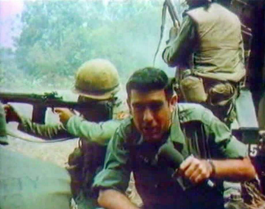 CBS newsman, Dan Rather reporting while under fire in Vietnam in 1966. Photo: CBS Photo Archive/CBS Via Getty Images