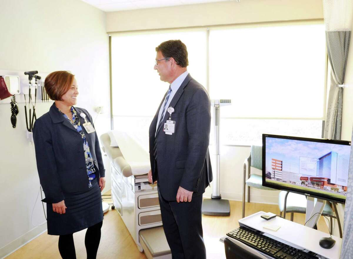 At left, Lisette Torres, Stamford Medical Group administrator, left, speaks with Dr. Rod Acosta, president and chief executive officer of Stamford Medical Group in a patient examination room in the Walk In Center at the Stamford Health Medical Group, Stamford Hospital's outpatient center in Stamford, Conn., Tuesday, Feb. 21, 2017. The facility located at 292 Long Ridge Road houses doctors focusing on primary care, cardiology, endocrinology, neurology, obstetrics, gynecology and orthopedics, as well as diagnostic imaging labs and a walk-in center.
