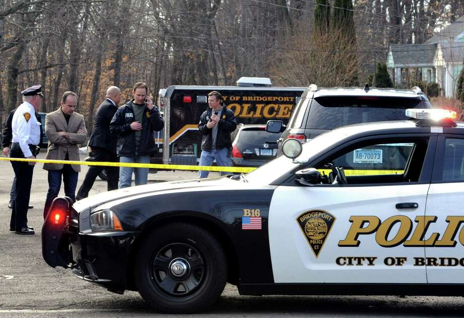 Mayor Joe Ganim and  investigators remain at the scene of a homicide at a home on Greenwood Road in Bridgeport, Conn. on the morning of Friday, Feb. 24, 2017. Police said a 26-year-old mother's killing was the result of domestic violence by her boyfriend, Oscar Hernandez, who lived at the home with her and their 6-year-old daughter, Aylin Sofia Hernandez. An Amber Alert has been issued for the young girl who is believed to have been taken by Hernandez. Photo: Cathy Zuraw, Hearst Connecticut Media / Connecticut Post