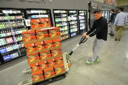 Chris Edgerton moves a pallet of beer at the LQR MKT store in Norwalk.