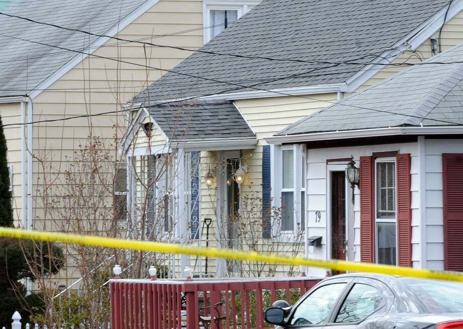 The scene of a homicide at a home on Greenwood Street in Bridgeport, Conn. remained active late in the morning on Friday, Feb. 24, 2017. Police said a 26-year-old mothers killing was the result of domestic violence by her boyfriend, Oscar Hernandez, who lived at the home with her and their 6-year-old daughter, Aylin Sofia Hernandez. Oscar Hernandez, wanted for a fatal stabbing, has been captured in Pennsylvania. Aylin Sofia Hernandez, is safe. Photo: Cathy Zuraw / Hearst Connecticut Media / Connecticut Post