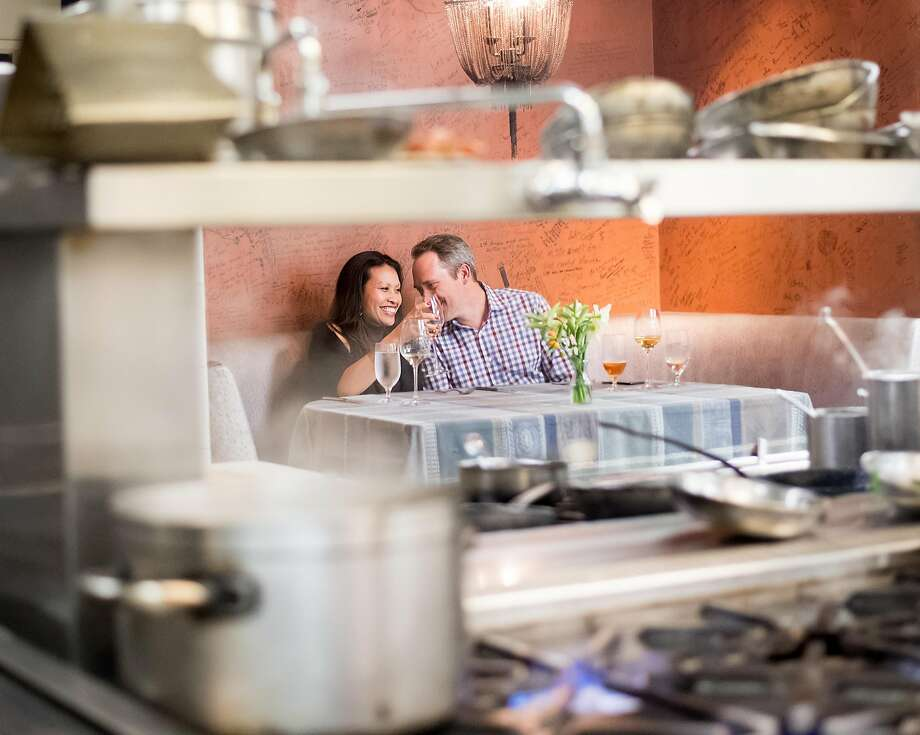 Karen and Darren Beyer celebrate their 15th anniversary at Lucia's chef's table, in the kitchen. Photo: Noah Berger, Special To The Chronicle