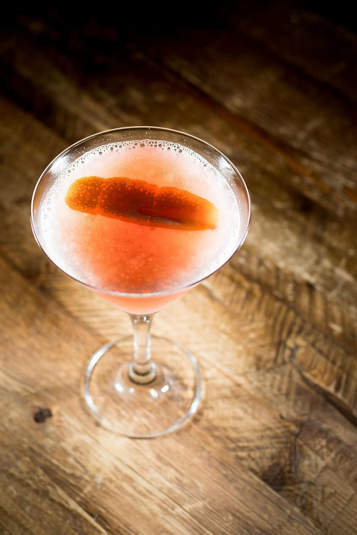 A Blinker cocktail, featuring Bourbon, grenadine and fresh squeezed grapefruit juice, rests on a table at Lucia on Thursday, February 16, 2017, in Carmel Highlands, Calif.