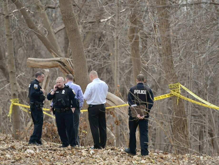 Schenectady police investigate the discovery of a body Friday morning in a wooded ravine between Wyllie Street and Interstate 890. Police said it is the body of a man. (Skip Dickstein / Times Union) Photo: Skip Dickstein / Times Union
