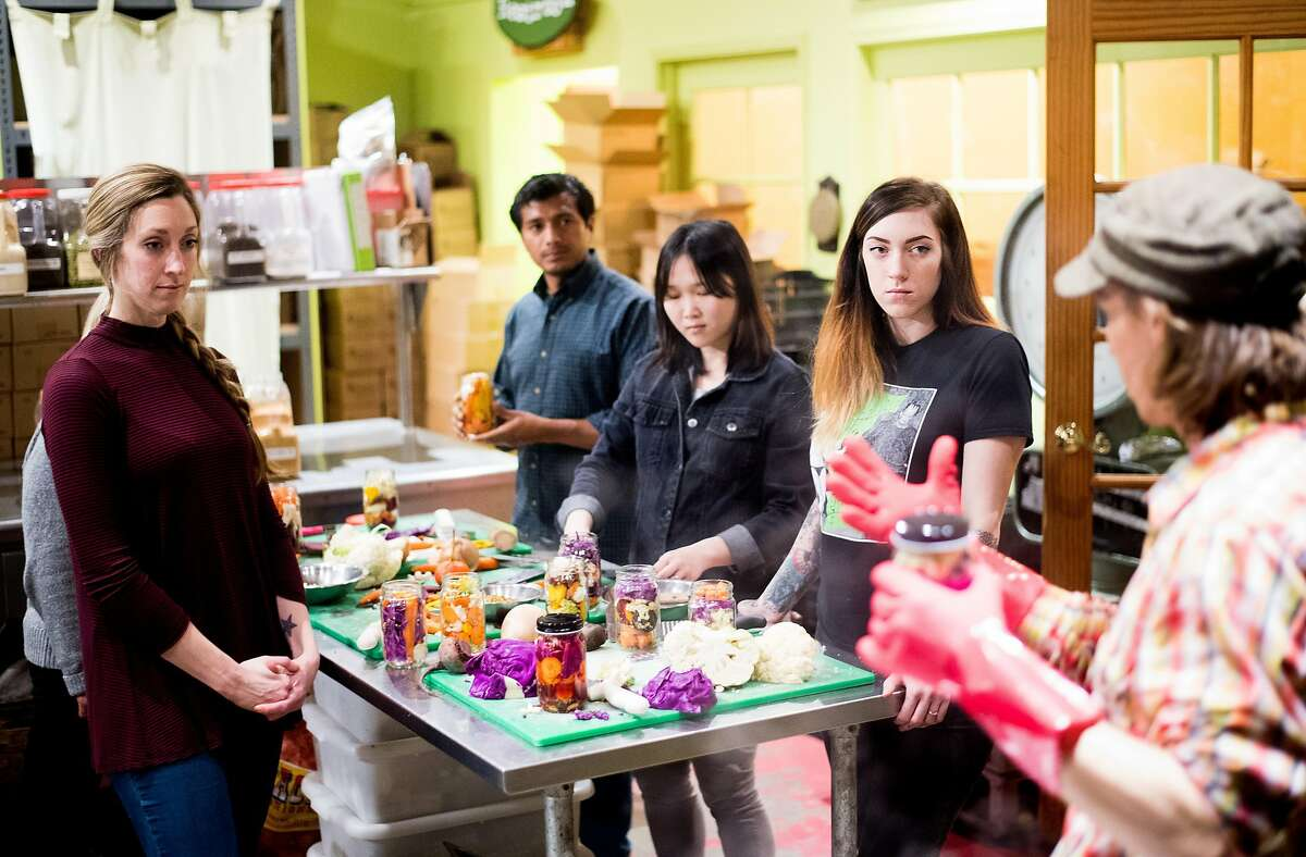 Krista Grimm, right, listens as Todd Champagne teaches a pickling class at Happy Girl Kitchen Company in Pacific Grove, Calif., on Thursday, Feb. 16, 2017.