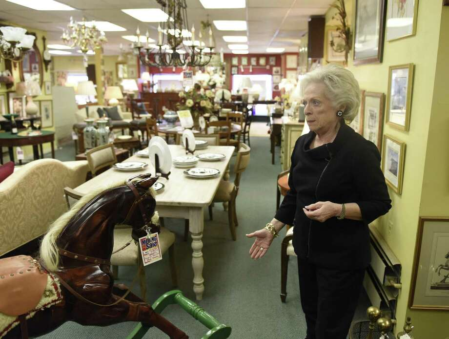 Owner Harriet Roughan shows items for sale in her consignment store, Estate Treasures, in Old Greenwich. Click through the slideshow to see the top 10 things people can do to declutter their lives.  Photo: Tyler Sizemore / Hearst Connecticut Media / Greenwich Time