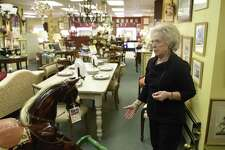 Owner Harriet Roughan shows items for sale in her consignment store, Estate Treasures, in the Riverside section of Greenwich, Conn. Wednesday, Feb. 15, 2017. After being a staple in town at her 7,500 sq. ft. location in Riverside for 35 years, Roughan is soon downsizing to a 2,600 sq. ft. location just down East Putnam Avenue in Old Greenwich.