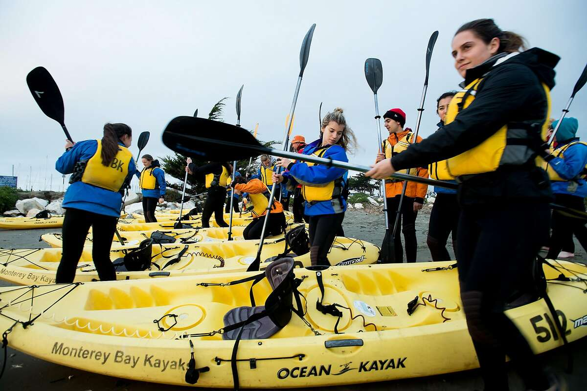 Students from the Menlo School prepare for an evening kayak tour in Moss Landing, Calif., on Thursday, Feb. 16, 2017.