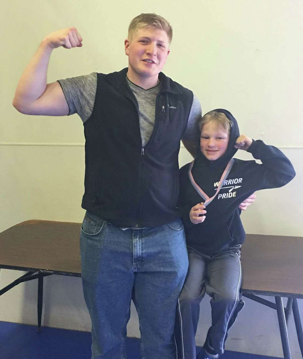 eckett Simmons of Wilton, pictured above right with Coach Sean DeJager, of Wilton Youth Wrestling.