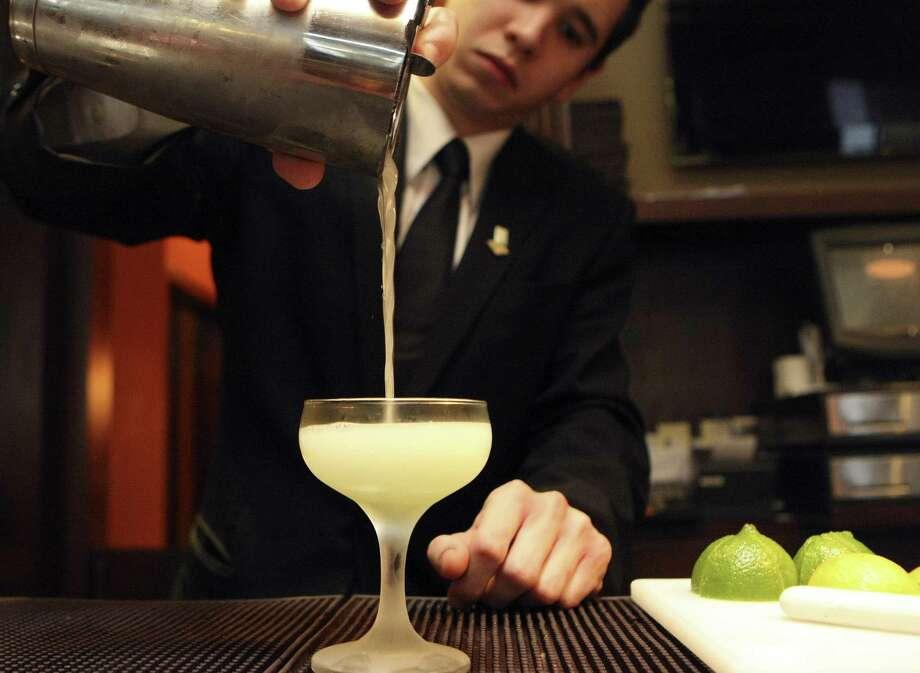 Jake Corney prepares an Ivy Gimlet at The Bar at Bohanan's. Photo: Express-News File Photo / SAN ANTONIO EXPRESS-NEWS