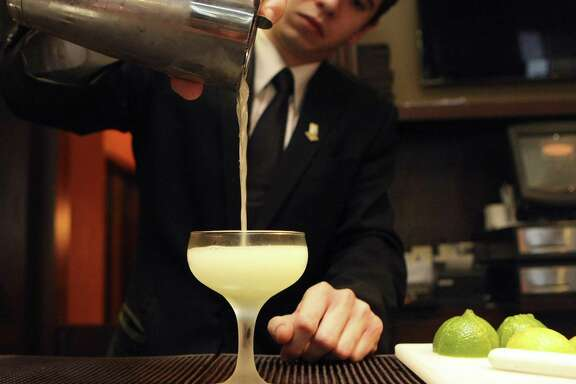 Jake Corney prepares an Ivy Gimlet at The Bar at Bohanan's.