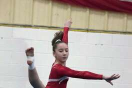 Mia Karlehag, a resident of Norawlk and member of the Wilton Y gymnastics team, competes during a qualifying meet earlier this month in Wilton.