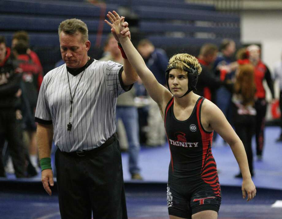 In this Feb. 18, 2017 photo, Euless Trinity's Mack Beggs is announced as the winner of a semifinal match after Beggs pinned Grand Prairie's Kailyn Clay during the finals of the UIL Region 2-6A wrestling tournament at Allen High School in Allen, Texas.   Beggs, who is transgender, is transitioning from female to male, won the girls regional championship after a female opponent forfeited the match. (Nathan Hunsinger/The Dallas Morning News via AP) Photo: Nathan Hunsinger, MBR / Associated Press / The Dallas Morning News