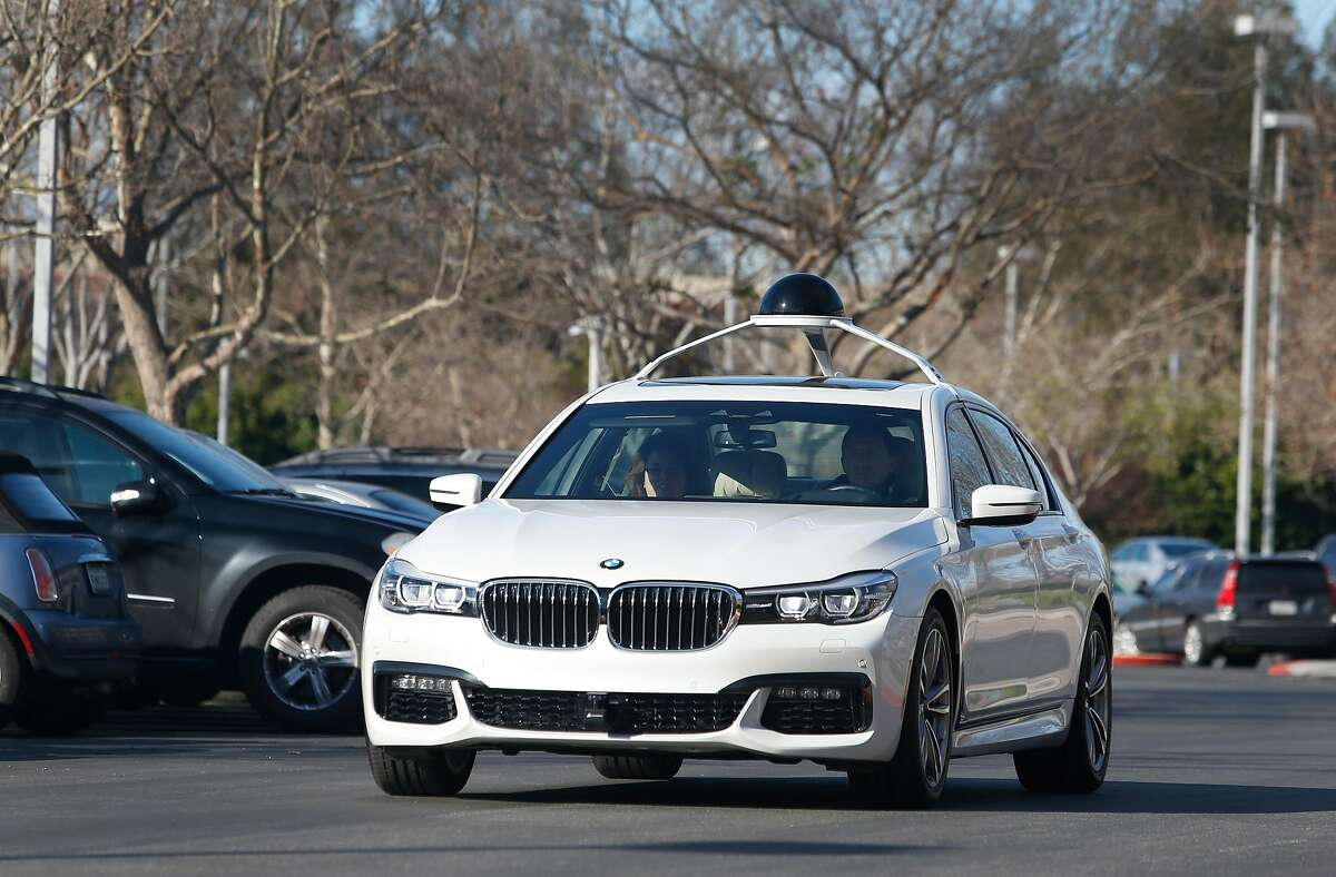 Patricia Robb and Thomas Lueftner ride in a test vehicle at Intel's Silicon Valley Autonomous Driving Innovation Center in San Jose, Calif. on Friday, Feb. 24, 2017. Construction work on a vehicle lab for Intel's self-driving car programs will begin soon inside an existing garage.
