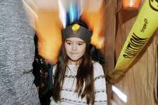 """Stark third-grade student Ewelina Yatskiy, 8, wears a miner's hat during the school tour of the virtual  """"Rock & Roll Cave"""" created by teacher Melissa Smith and her third-grade class to teach students about the wonders of rocks, minerals and geology at the Julia A. Stark Elementary School in Stamford, Conn., Friday, Feb. 24, 2017. Smith said """"all the students got so into it. We love rocks and minerals and want to teach about the science and the wonders that the earth has to offer."""""""