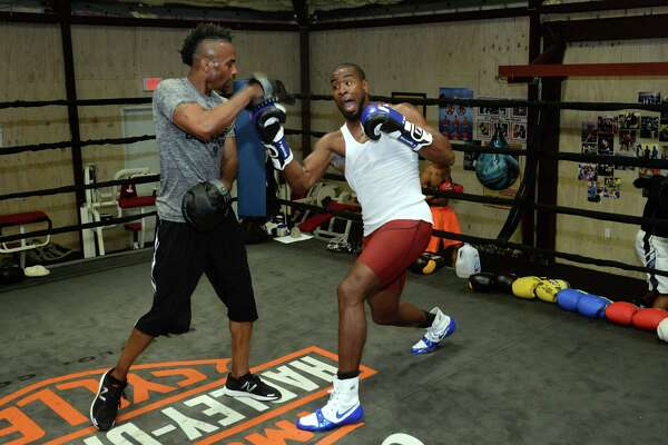 Quantis Graves, right, trains with Shedrick Lewis at Beaumont Boxing on Tuesday. Graves will fight Floyd Mayweather's Andrew Tabiti for a Cruiserweight Championship on Friday. The fight will be televised on Showtime.  Photo taken Tuesday, February 23, 2017 Guiseppe Barranco/The Enterprise