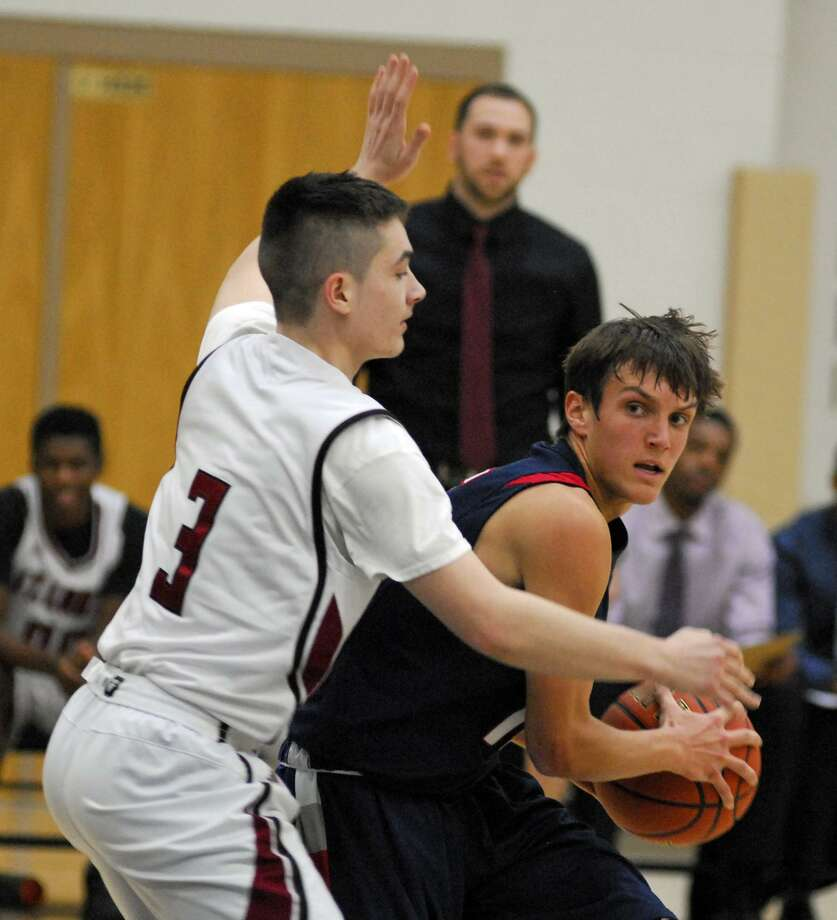 St. Luke's Andrew Varoli, right, defends Greens Farms Academy's Cole Prowitt-Smith during a game on Tuesday. Photo: Ryan Lacey / Hearst Connecticut Media
