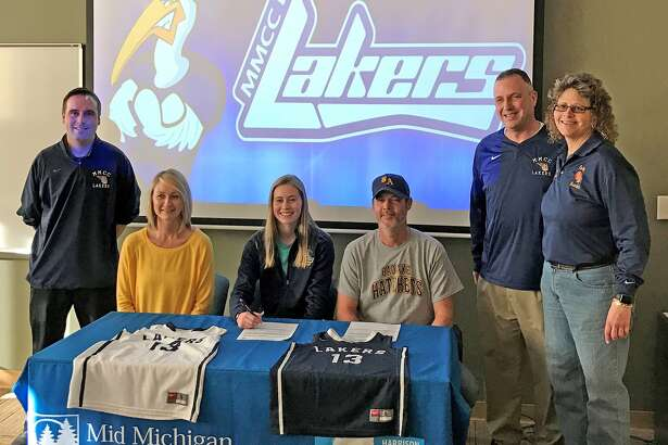 Bad Axe basketball standout Breyton Meeks recently signed her letter of intent to continue her career at Mid Michigan Community College. Pictured from left are MCC assistant Coach Fletcher, Jill Meeks (mother) Breyton Meeks, Glen Meeks, (father), head Coach Matt Rodenbo and Bad Axe girls assistant coach Susan M. Schrader.  