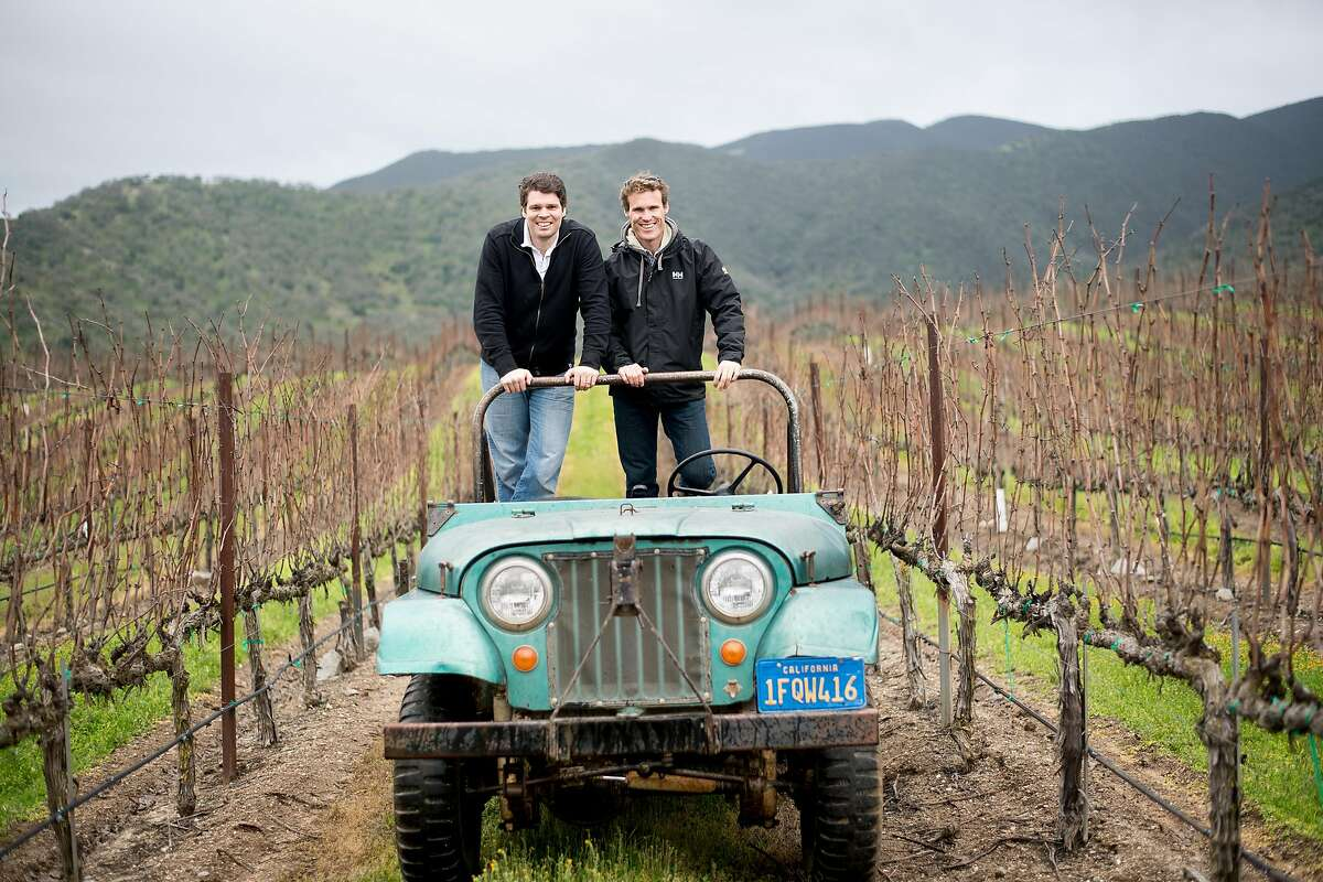 Mark, right, and Jeff Pisoni stand in a Willy's jeep at Pisoni Vineyards in Gonzales, Calif., on Sunday, Feb. 19, 2017.