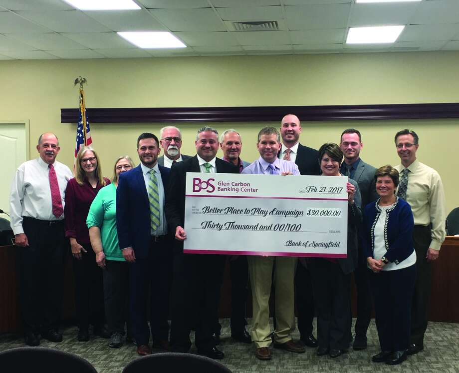 The Bank of Springfield poses with the Edwardsville City Council after donating $30,000 to the Better Place to Play Campaign to contribute to the development of the Plummer Family Sports Park. Photo: Cody King • Intelligencer