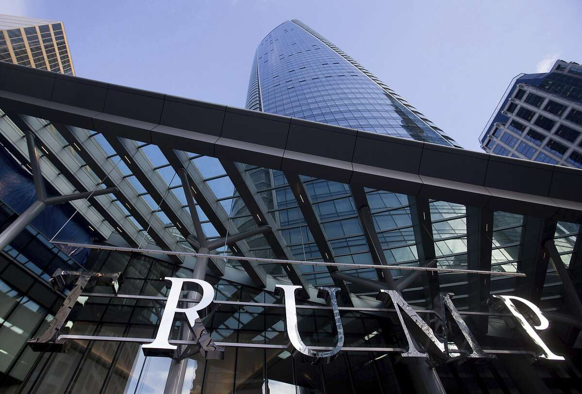 This Jan. 20, 2017 photo shows the still-under-construction Trump International Hotel and Tower in Vancouver, British Columbia, Canada. The 69-story tower has drawn praise for its sleek, twisting design. Prices for the condominiums have set records. But the politics of President Donald Trump have caused such outrage that the mayor wouldn't attend the Feb. 28, 2017 grand opening and has lobbied for a name change.