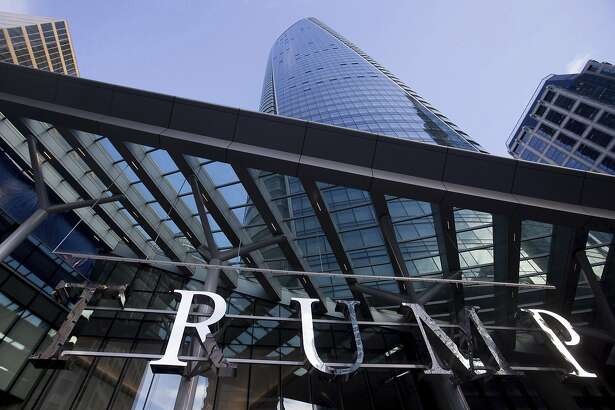 This Jan. 20, 2017 photo shows the still-under-construction Trump International Hotel and Tower in Vancouver, British Columbia, Canada. The 69-story tower has drawn praise for its sleek, twisting design. Prices for the condominiums have set records. But the politics of President Donald Trump have caused such outrage that the mayor won�t attend the Feb. 28 grand opening and has lobbied for a name change. (Darryl Dyck/The Canadian Press via AP)