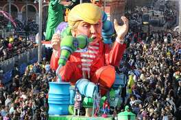 "TOPSHOT - People look at the float ""Wind of Change"" depicting US President Donald Trump as it parades in the streets of Nice for the 133rd edition of the Nice Carnival on February 19, 2017 in Nice, southeastern France. The Nice carnival runs until February 25, 2017 under the theme ""The King of Energies"".  / AFP / VALERY HACHE        (Photo credit should read VALERY HACHE/AFP/Getty Images)"