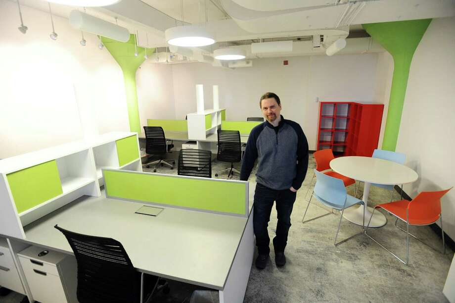 Clay Keller, Dream Payments' cloud and network architect, poses for a photo inside the Canadian online payment firms first U.S. office, located at Comradity on Canal St. in Stamford, Conn. on Tuesday, Feb. 21, 2017. Photo: Michael Cummo / Hearst Connecticut Media / Stamford Advocate