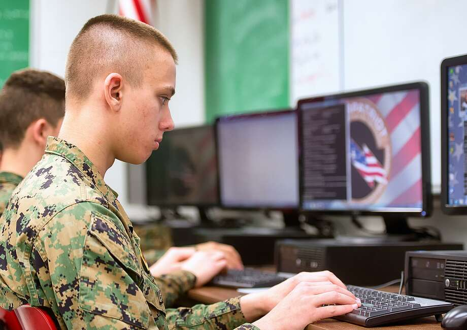 In this photo taken March 10, 2015, George Zenner, team captain of the Marine Military Academy CyberPatriot team, practices his security skills before the competition this week in Harlingen, Texas.  (AP Photo/Valley Morning Star, David Pike) Photo: David Pike, MBR / Associated Press / Valley Morning Star