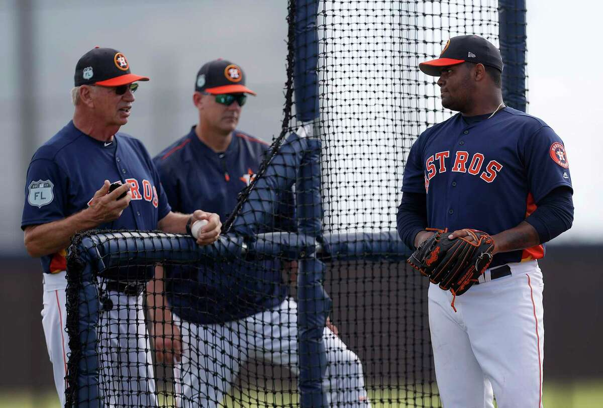 Houston Astros pitcher Francis Martes (79) pauses between pitches to chat with Houston Astros manager A.J. Hinch and Triple A pitching coach Dyar Miller during spring training at The Ballpark of the Palm Beaches, in West Palm Beach, Florida, Friday, February 24, 2017.