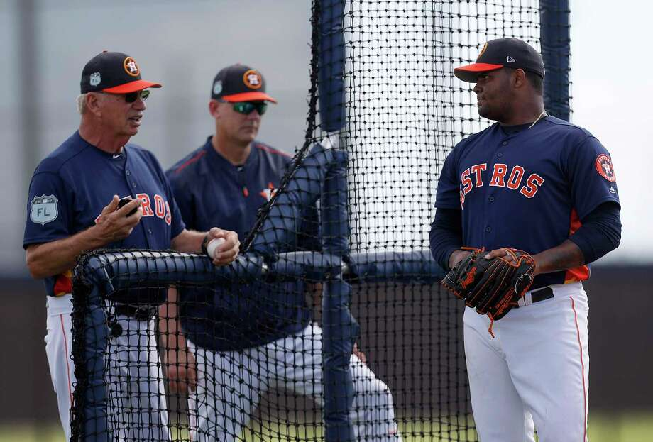 Houston Astros pitcher Francis Martes (79) pauses between pitches to chat with Houston Astros manager A.J. Hinch and Triple A pitching coach Dyar Miller during spring training at The Ballpark of the Palm Beaches, in West Palm Beach, Florida, Friday, February 24, 2017. Photo: Karen Warren, Houston Chronicle / 2017 Houston Chronicle