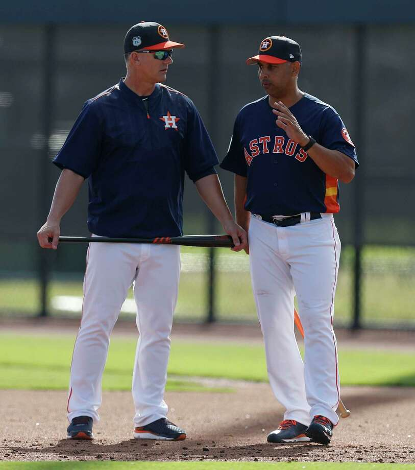 Houston Astros manager A.J. Hinch and bench coach Alex Cora talk during spring training at The Ballpark of the Palm Beaches, in West Palm Beach, Florida, Friday, February 24, 2017. Photo: Karen Warren, Houston Chronicle / 2017 Houston Chronicle