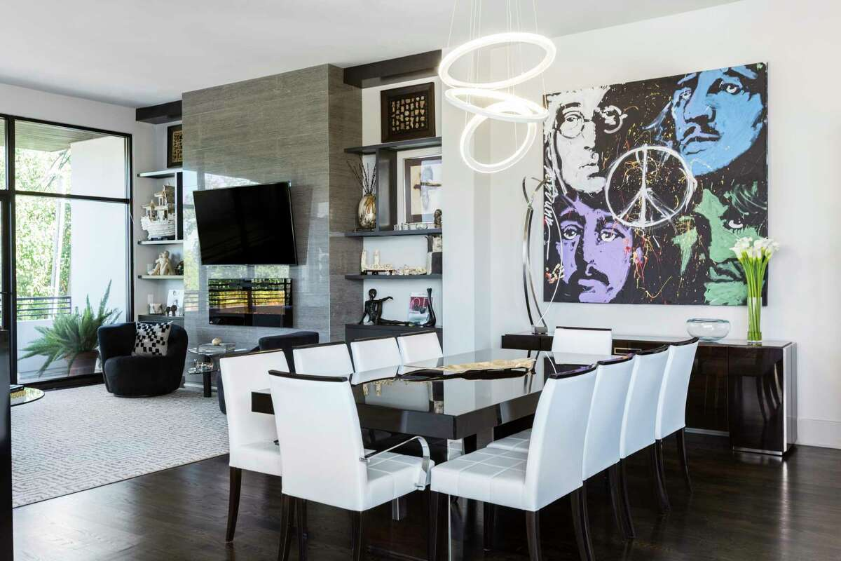 Glossy new furniture adds to the fresh start Ed and Harriet Reitman are getting in their new modern Galleria-area home.