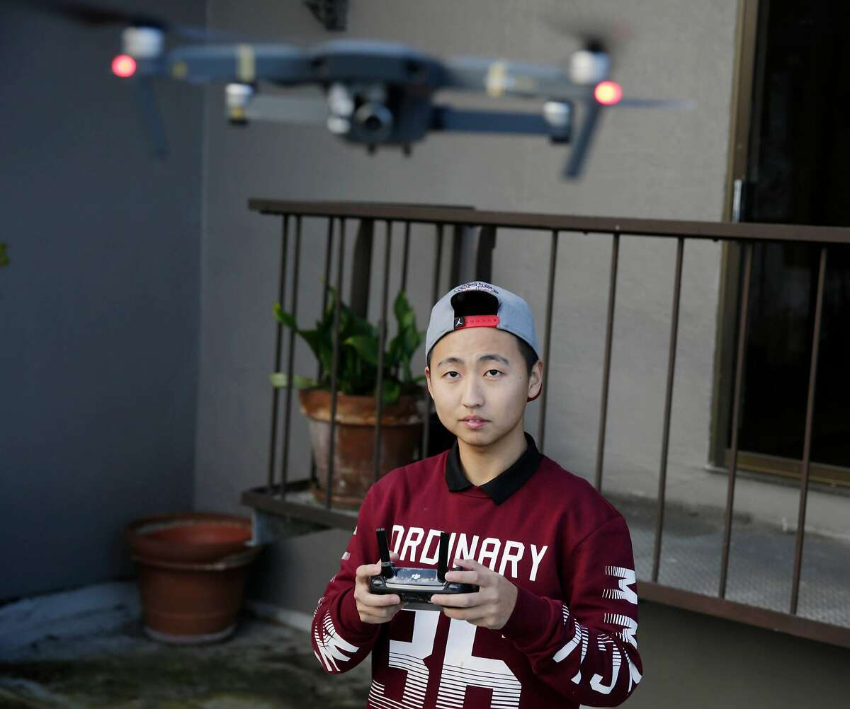 Bruce Lu, Magic Sky pilot, flys the DJI Mavic drone on a outdoor deck at the new DJI store on Montgomery Street the day before it's grand opening on Friday, February 24, 2017 in San Francisco, Calif.