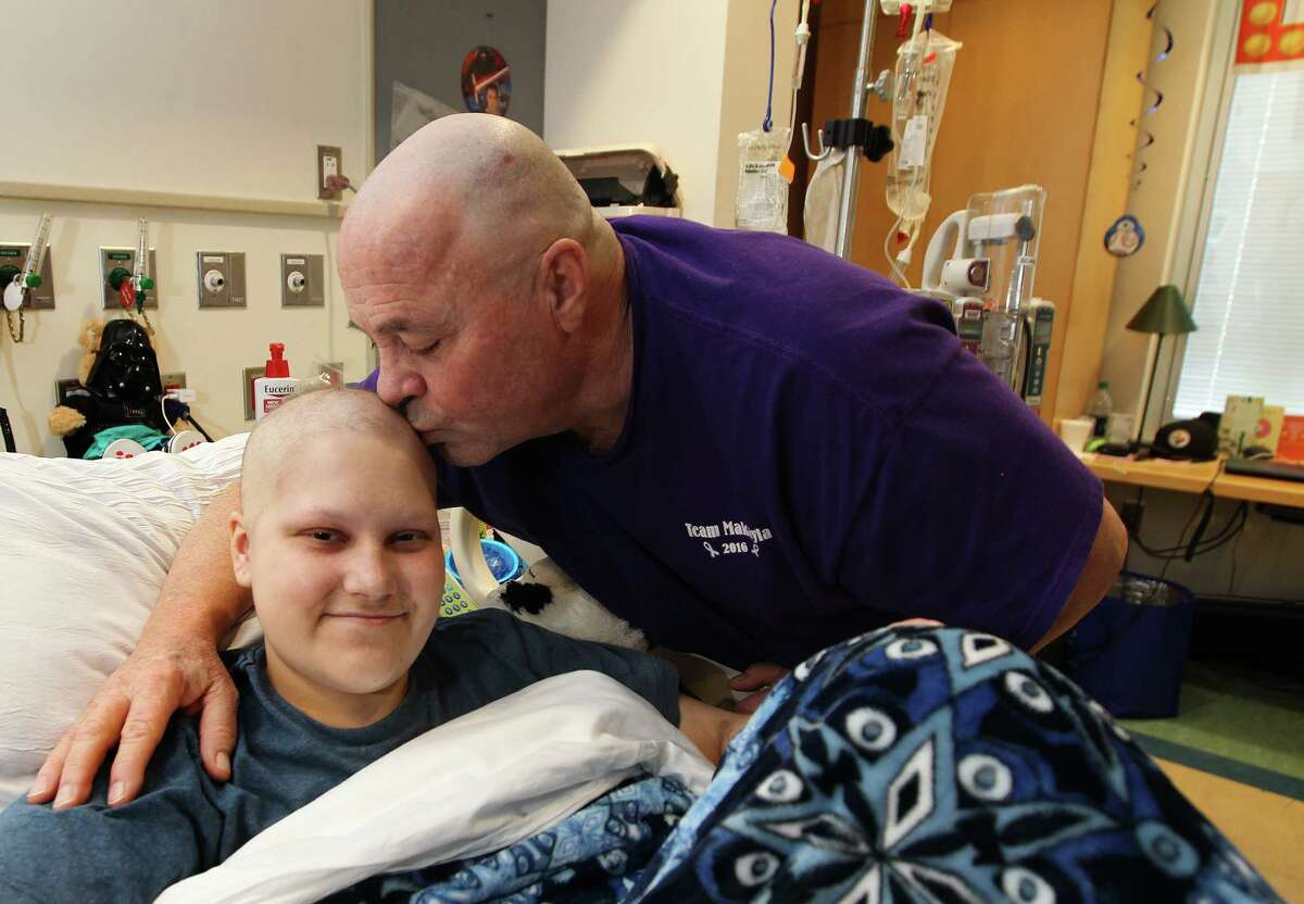Phillip Blanton and granddaughter Makayla Farley in Methodist isolation room Thursday, Jan. 19, 2017, in Houston. Blanton drove from California to be with Makayla, 20, who's has Hodgkin's lymphoma, but was arrested en route in north Texas for medical marijuana he was bringing for her. He's been released, but he faces felony drug possession charges.
