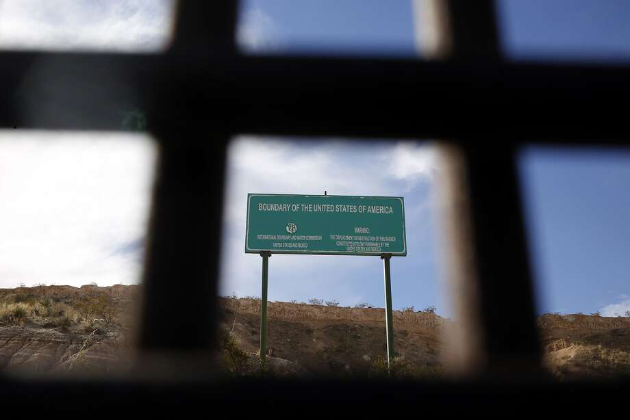 A boundary marker stands next to a border fence that separates the U.S. and Mexico in Sunland Park, New Mexico, U.S., on Friday, Feb. 17, 2017. The Trump administration outlined a sweeping crackdown on undocumented immigrants Tuesday, pledging to hire 15,000 more border patrol and immigration agents and to begin building a wall on the Mexican border to enact executive orders signed by the president on Jan. 25. Photographer: Luke Sharrett/Bloomberg Photo: Luke Sharrett, Bloomberg