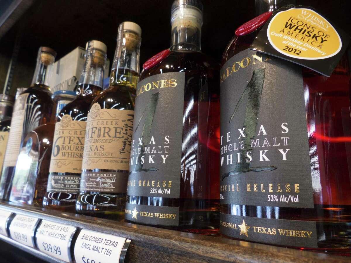 Ranger Creek .36 Texas Bourbon Whiskey, Ranger Creek Rimfire Texas Single Malt Whiskey and Balcones Texas Single Malt Whisky are placed on the shelf at WB Liquors.
