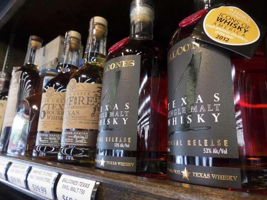 Ranger Creek .36 Texas Bourbon Whiskey, Ranger Creek Rimfire Texas Single Malt Whiskey and Balcones Texas Single Malt Whisky are placed on the shelf at WB Liquors. Photo: Billy Calzada /San Antonio Express-News / San Antonio Express-News