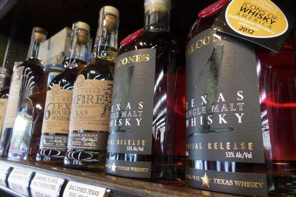 Ranger Creek .36 Texas Bourbon Whiskey, Ranger Creek Rimfire Texas Single Malt Whiskey and Balcones Texas Single Malt Whisky are placed on the shelf at WB Liquors.