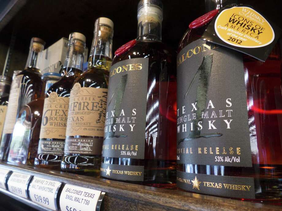 "Ranger Creek .36 Texas Bourbon Whiskey, Ranger Creek Rimfire Texas Single Malt Whiskey and Balcones Texas Single Malt Whisky are placed on the shelf under ""flavorful spicy"" at WB Liquors. Photo: Billy Calzada /San Antonio Express-News / San Antonio Express-News"