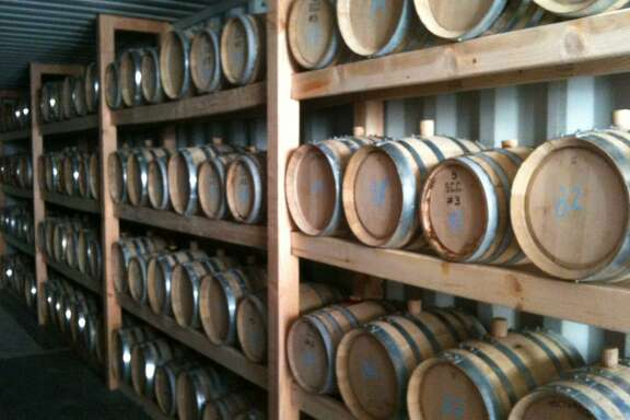 Barrels of bourbon age at Ranger Creek Brewing and Distilling.